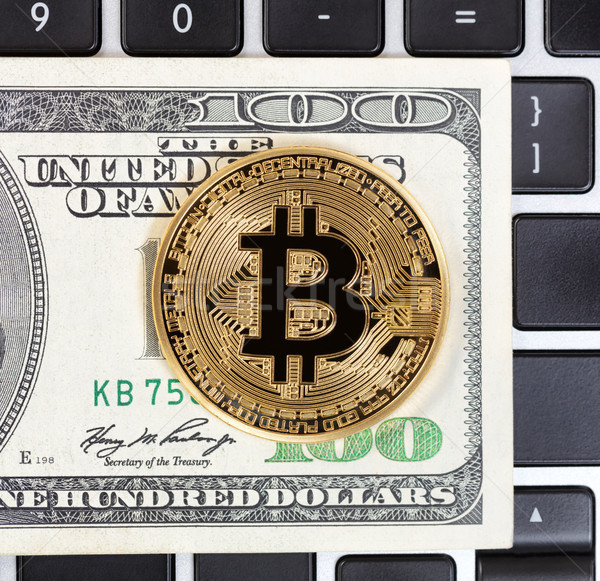 Gold Bitcoin with paper currency and computer keyboard in backgr Stock photo © tab62