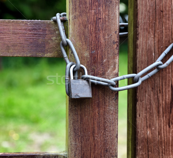 Outdoor property secured with strong lock on wooden fence post  Stock photo © tab62