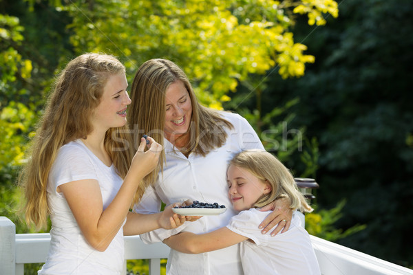 Family of Girls enjoying a moment together while eating fresh fr Stock photo © tab62