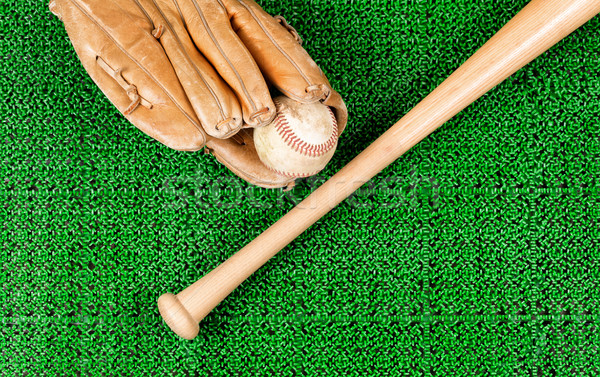 Baseball equipment on artificial green grass turf field  Stock photo © tab62