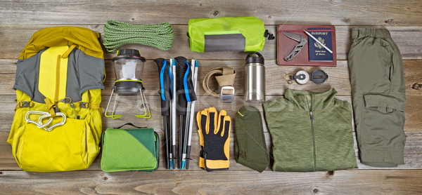 Hiking and camping gear organized on rustic wooden boards  Stock photo © tab62