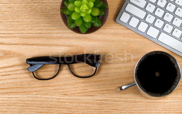 Wooden red oak desktop with bare work essentials  Stock photo © tab62