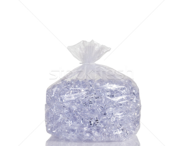 Clear plastic bag filled with ice cubes isolated on white backgr Stock photo © tab62