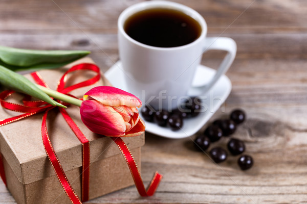 Single cut tulip on gift box with coffee and chocolate on stress Stock photo © tab62