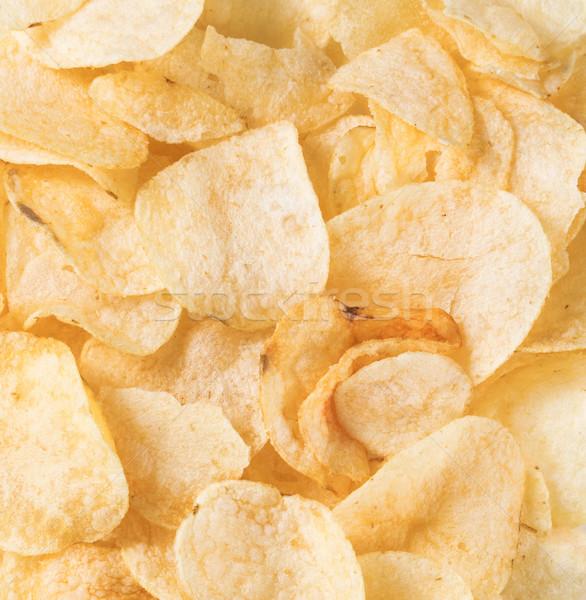 Filled frame of crunchy fresh potato chips Stock photo © tab62