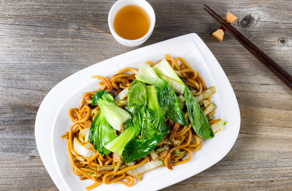 Chinese spicy noodle and vegetable dish with green tea Stock photo © tab62