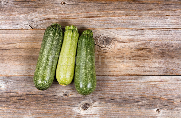 Fresh cucumbers on rustic wooden boards Stock photo © tab62