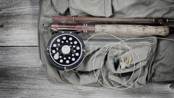 Old trout fishing gear on top of fishing vest  Stock photo © tab62