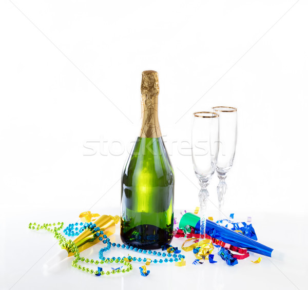New Year eve party decorations and champagne with drinking glass Stock photo © tab62