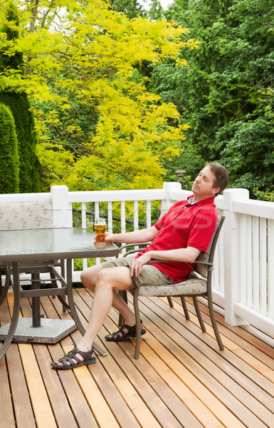 Lazy Man drinking Beer while outdoors on patio  Stock photo © tab62