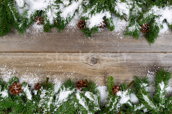 Christmas border with snow covered branches on rustic wooden boa Stock photo © tab62