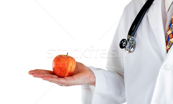 Partial side view of doctor holding apple on white background Stock photo © tab62