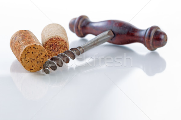 Traditional corkscrew with corks on glass table  Stock photo © tab62