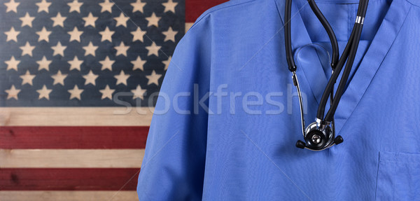 Close up of blue medical scrubs and stethoscope with rustic USA  Stock photo © tab62