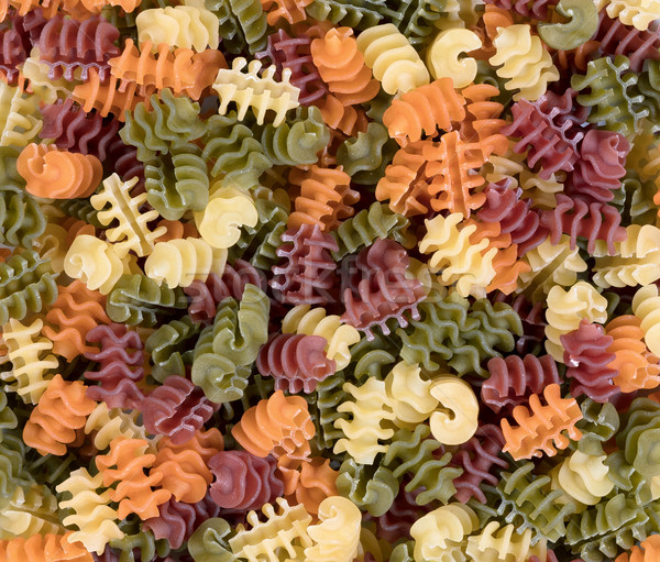 Colorful food background of raw twisted pasta Stock photo © tab62