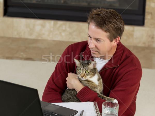 Volwassen man familie huisdier werken home Stockfoto © tab62
