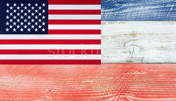 American flag with national colors painted on fading wooden boar Stock photo © tab62