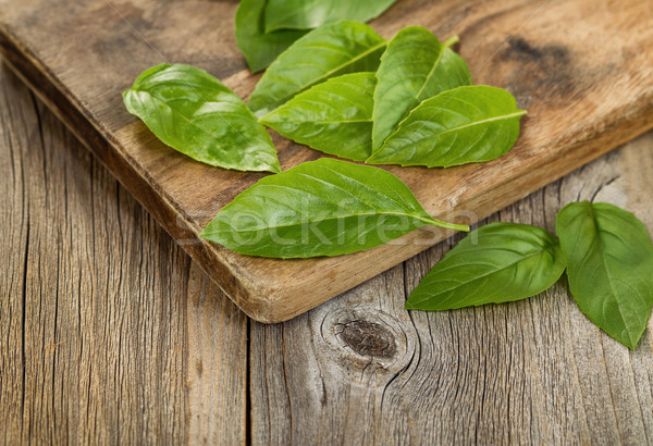 Close up fresh basil leafs on rustic serving board  Stock photo © tab62
