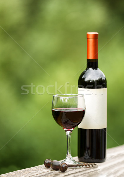 Glass of red wine outdoors ready to enjoy Stock photo © tab62