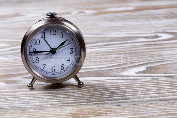 Traditional vintage alarm clock on white wooden boards Stock photo © tab62