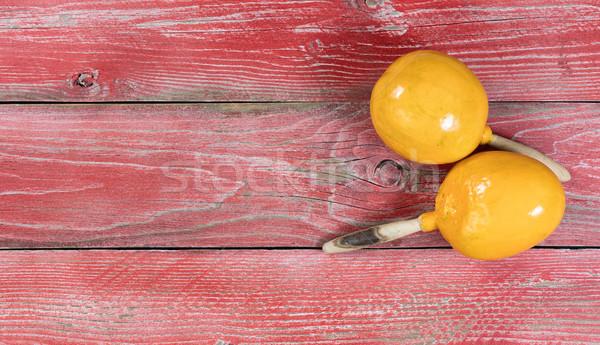 Traditional maracas for Cinco de Mayo holiday celebration on red Stock photo © tab62