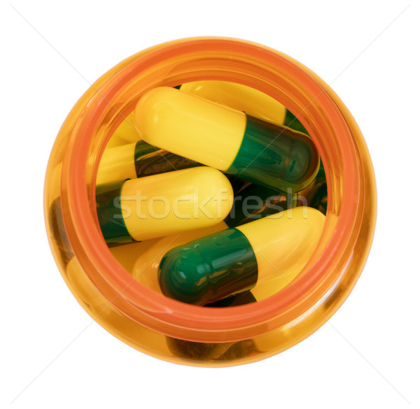 Medicine bottle filled with capsules isolated on white backgroun Stock photo © tab62