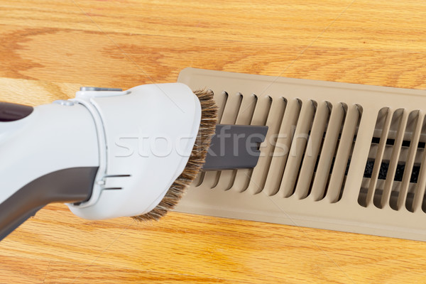 Cleaning heater vent withVacuum Stock photo © tab62