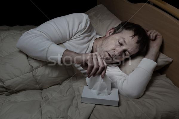 Beteg érett férfi papírzsebkendő ágy vízszintes kép Stock fotó © tab62