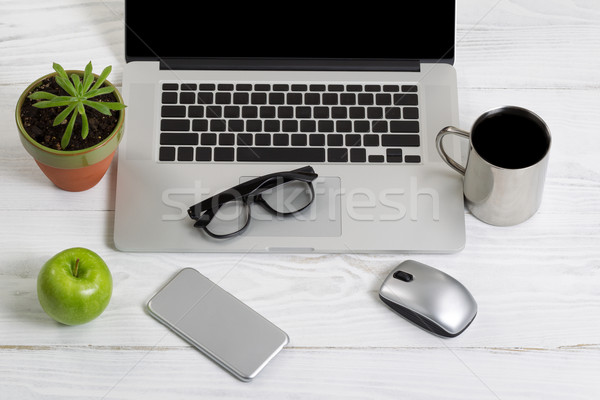 Clean and organized work space on white desktop Stock photo © tab62