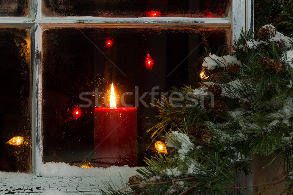 Glowing Christmas candle in frosted home window Stock photo © tab62