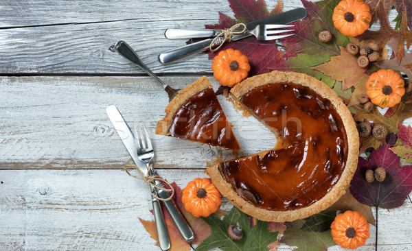 A slice of freshly baked pumpkin pie for the autumn holidays in  Stock photo © tab62