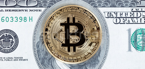 Bitcoin cyber single coin on paper currency background   Stock photo © tab62