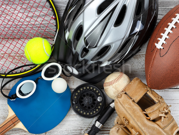 Used sports equipment placed on white rustic wooden background  Stock photo © tab62