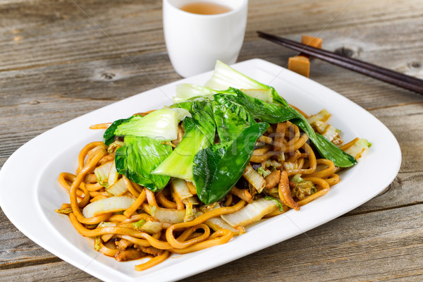 Chinese spicy noodle and vegetable dish in plate setting ready t Stock photo © tab62