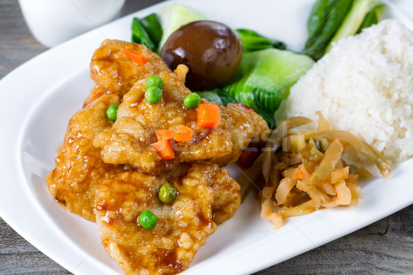 Fried fish and extras for lunch meal in white plate ready to eat Stock photo © tab62