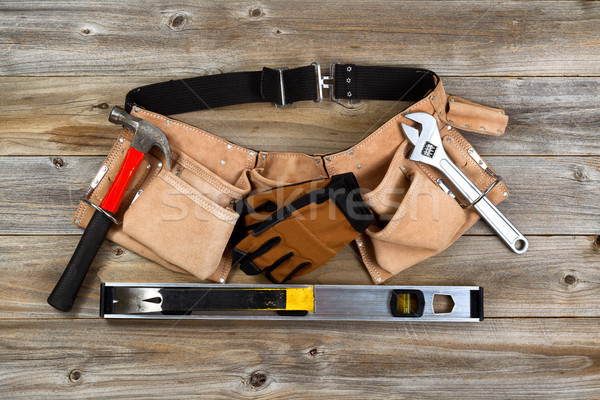 Leather tool belt with tools on rustic wooden boards  Stock photo © tab62