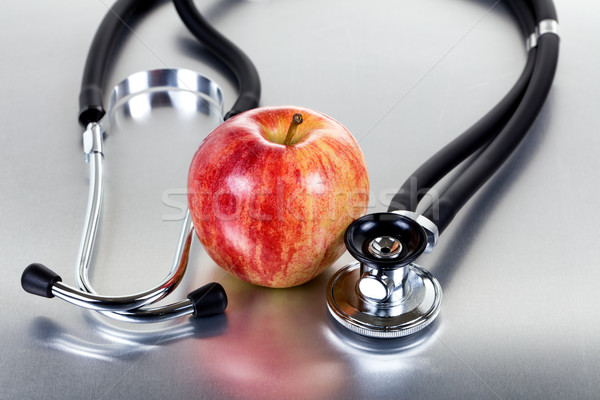 Fresh red apple and stethoscope on stainless steel  Stock photo © tab62