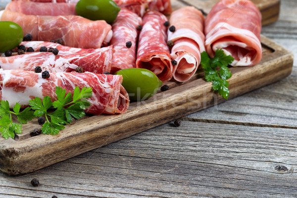 Various raw meats on serving board with rustic background  Stock photo © tab62