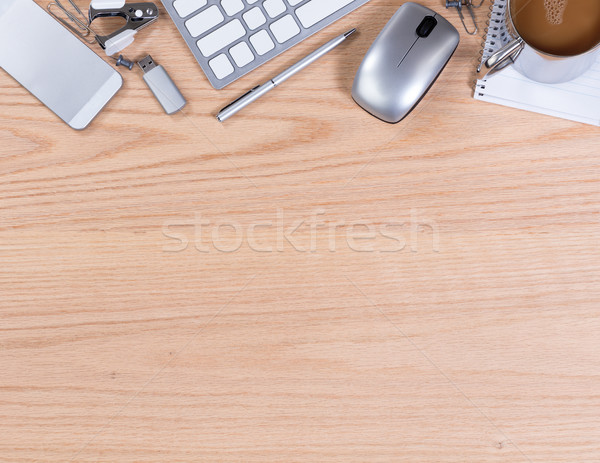 Wooden desktop with various office equipment on upper border of  Stock photo © tab62