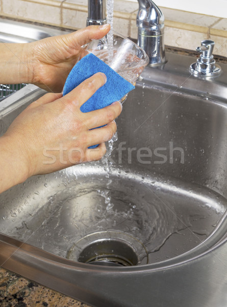 Female hands running water into Soapy Drinking Glass Stock photo © tab62