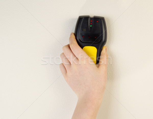 Electronic Stud Finder against interior wall of home  Stock photo © tab62