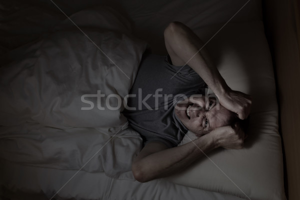 Mature man angry from not being able to sleep  Stock photo © tab62