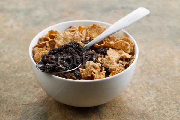 Grain Cereal and Raisins in white bowl  Stock photo © tab62