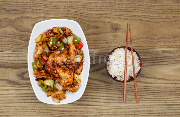 Chinese Spicy Chicken Dish with Rice in bowl on faded wood  Stock photo © tab62