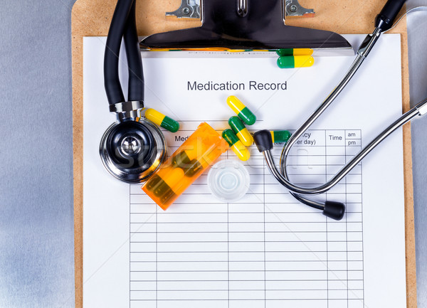 Clipboard with patient medication record plus pills and equipmen Stock photo © tab62
