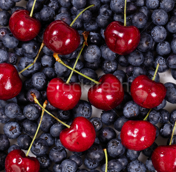 Fresh blueberries and cherries in filled frame format  Stock photo © tab62