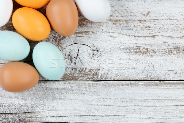 colorful real eggs on rustic white wood for Easter Background  Stock photo © tab62