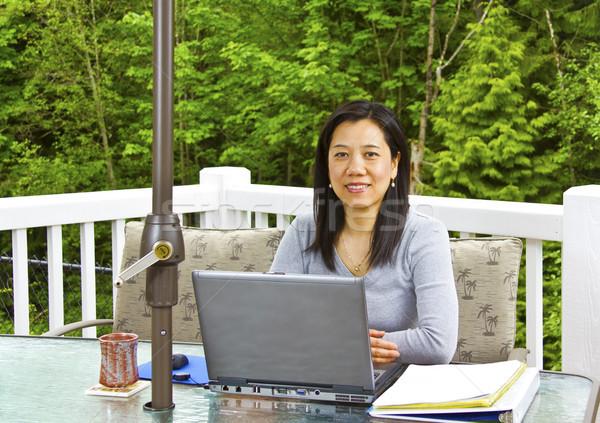 Dame travail maison extérieur patio asian Photo stock © tab62