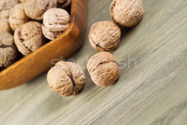 Close up of Whole Walnuts on Faded Wood  Stock photo © tab62