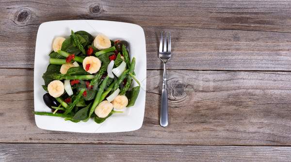 Overhead view of a nutritional fresh salad on rustic table  Stock photo © tab62